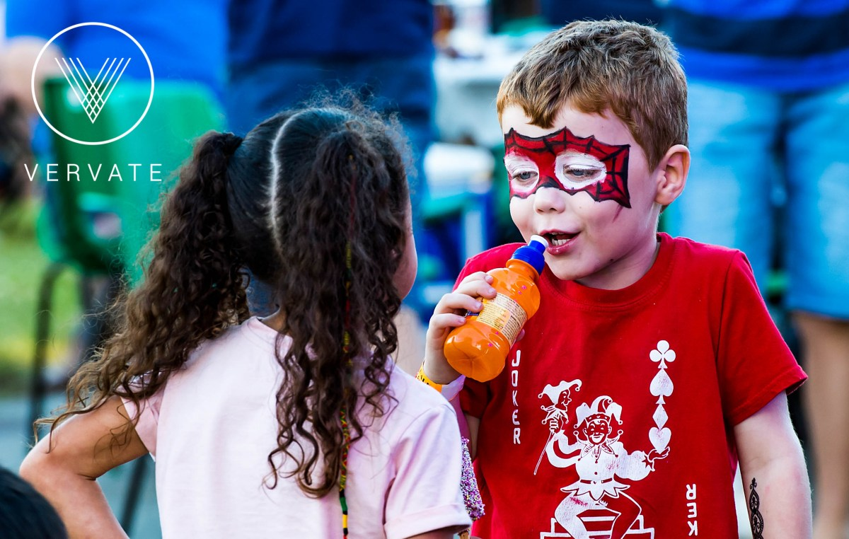 small boy with face paints laughs LVS Ascot Party in the Park 2017