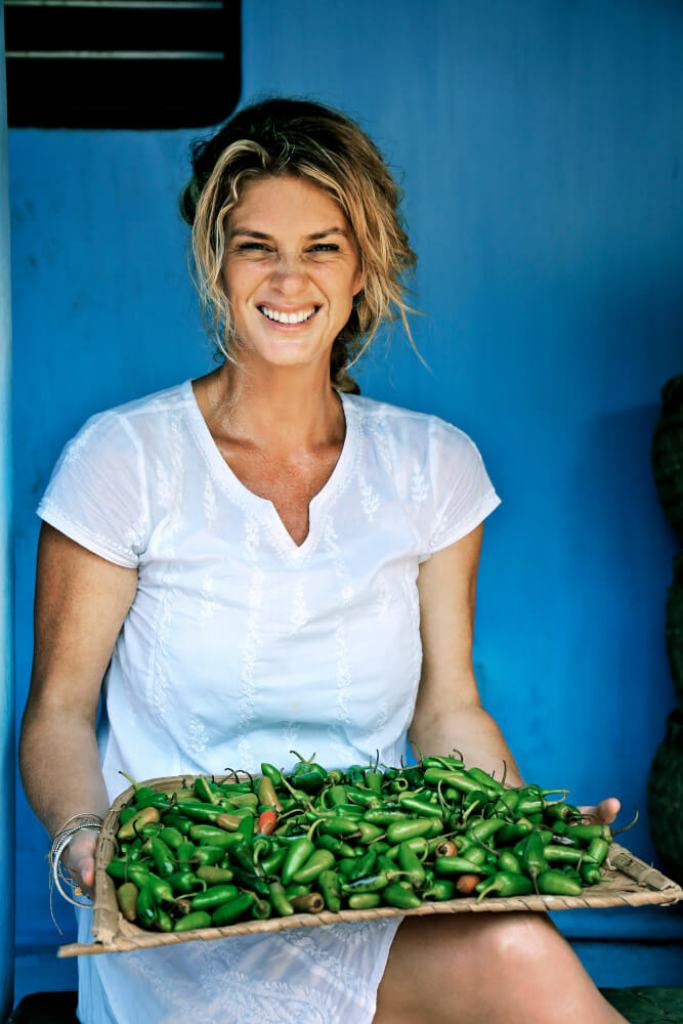 Rachel holds some locally grown chillis in Kerala, India. (ep 7).