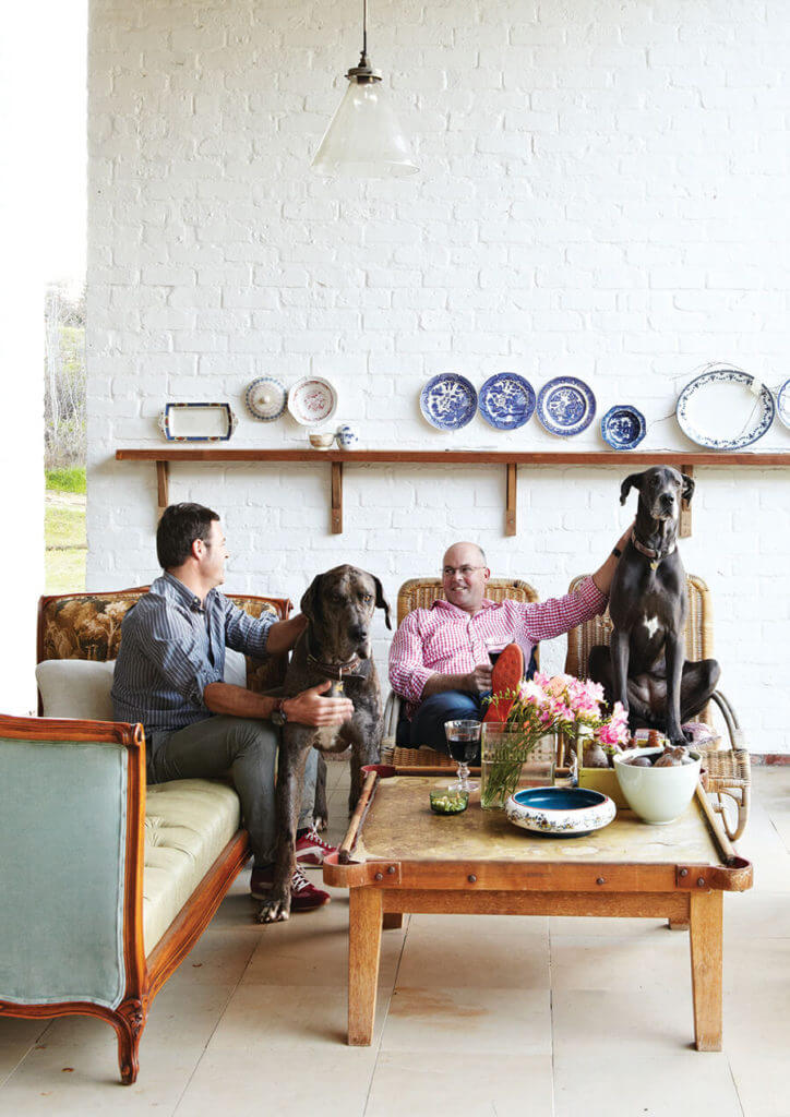 Dane and Chris with Lela and Sebastian. The plates on the wall were Dane's mother's.