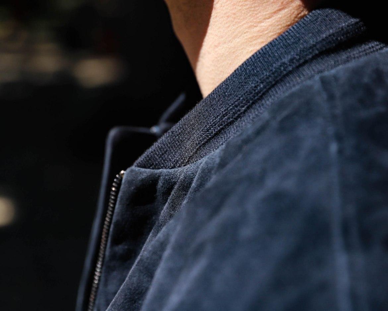 bords cote blouson cuir bleu marine