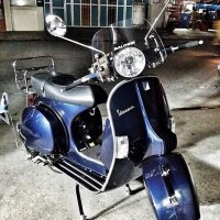 Midnight blue Vespa PX with accessories