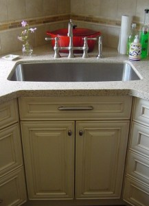 single sink under mounted in corner of kitchen