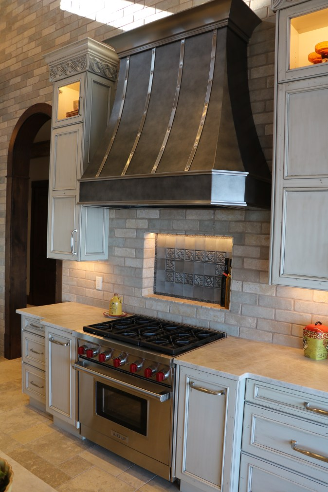 Cooking zone with custom hood and pro gas range