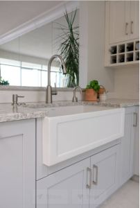 White apron front sink under mounted in countertop