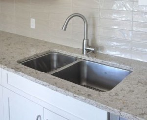 one and a half bowl sink under mounted with reveal