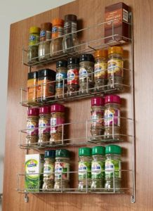 spice shelf on door made from chrome wire