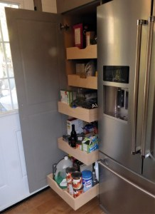 rollout shelves at different heights in pantry