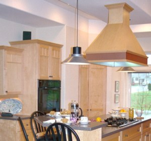 single wall oven and gas cooktop in maple kitchen