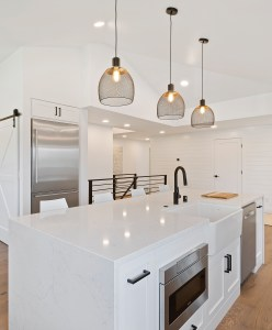 Statement pendant lights over kitchen island