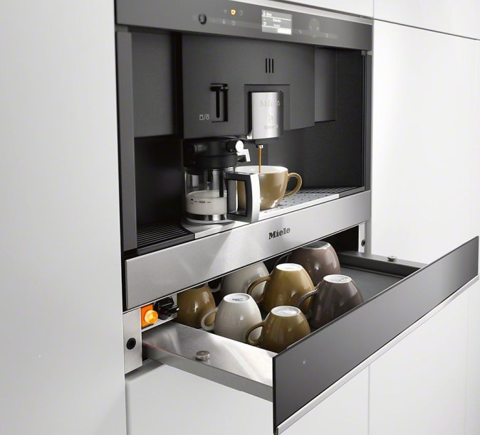 built in coffee maker with cup warmer drawer below
