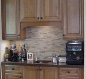 coffee center in a niche with prep sink and hot water dispenser