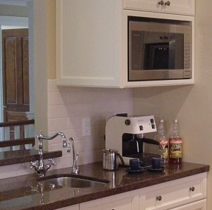Coffee area under microwave and beside prep sink