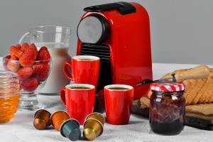 red coffee machine that uses pods