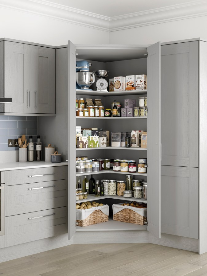 corner pantry with two doors and L-shaped shelves