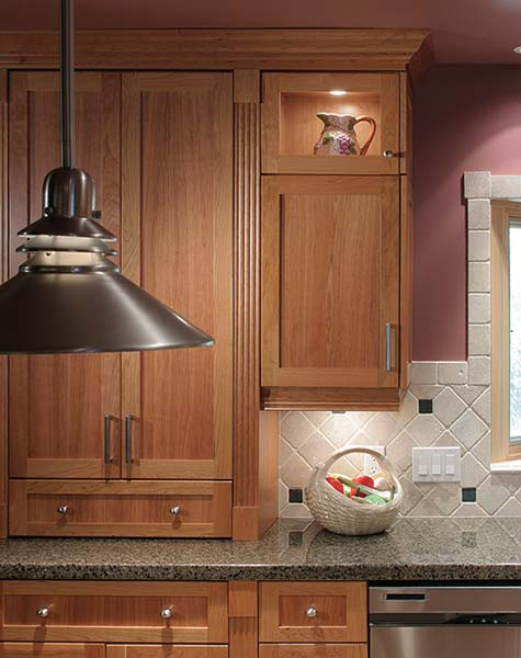 cherry cabinets with fluted upper pilasters