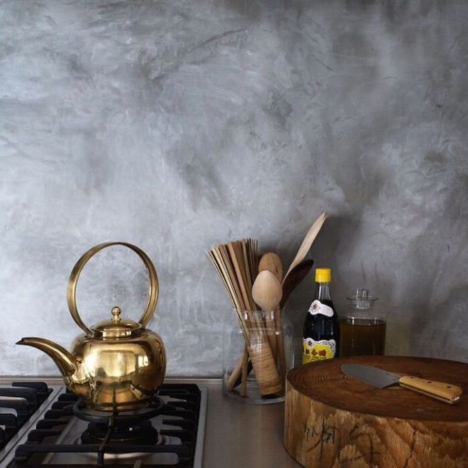 grey toned plaster backsplash