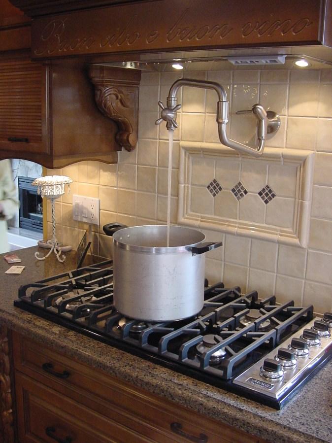 gas cooktop with pot filler in backsplash