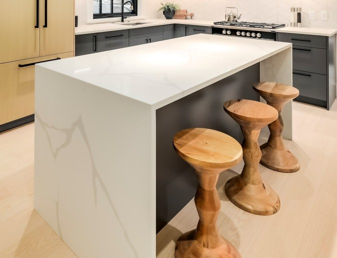 dining bar with waterfall counters