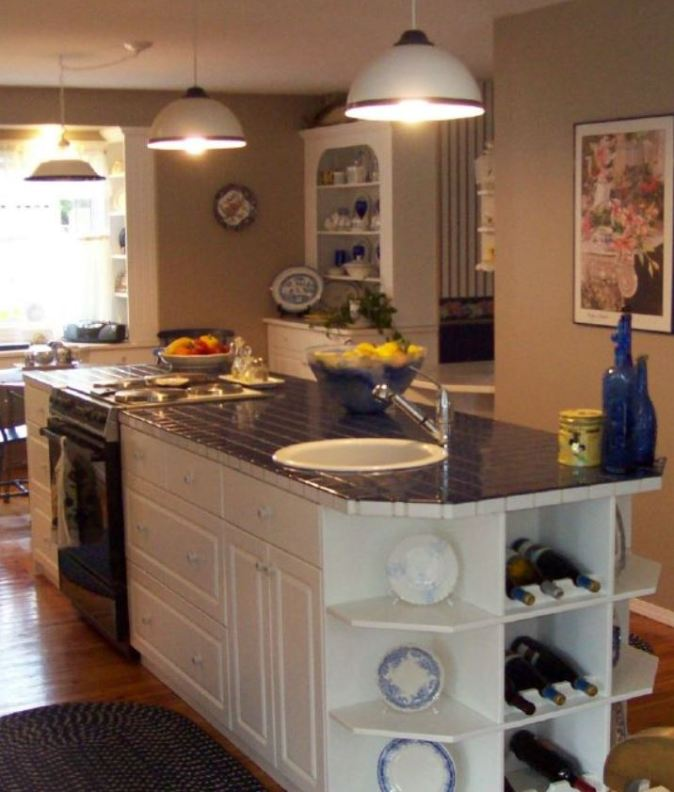 white kitchen island with blue tile countertop