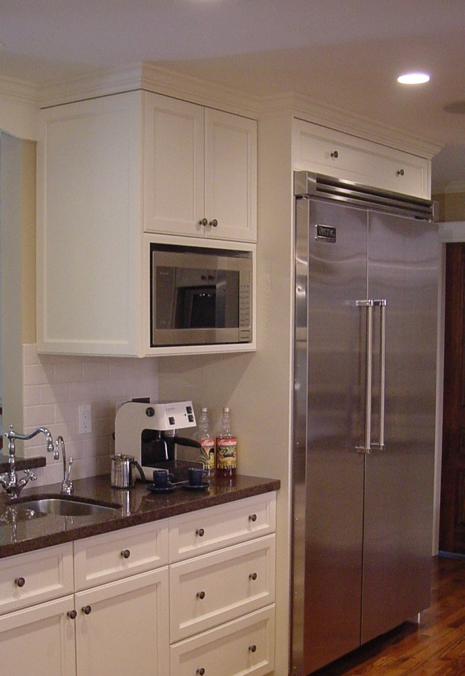 white cabinet with ss microwave