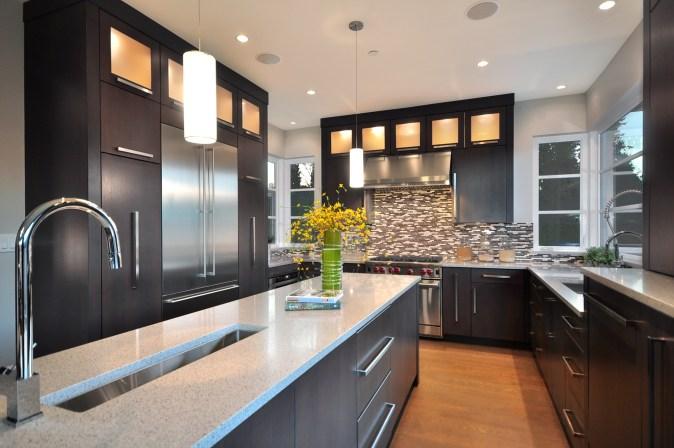Vestabul designed U-shaped kitchen with center island.