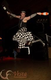 Vesta performer leaps very high on stilts