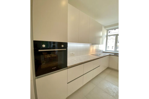 white kitchen with black oven