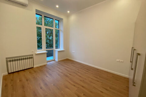 white room with window and wardrobe