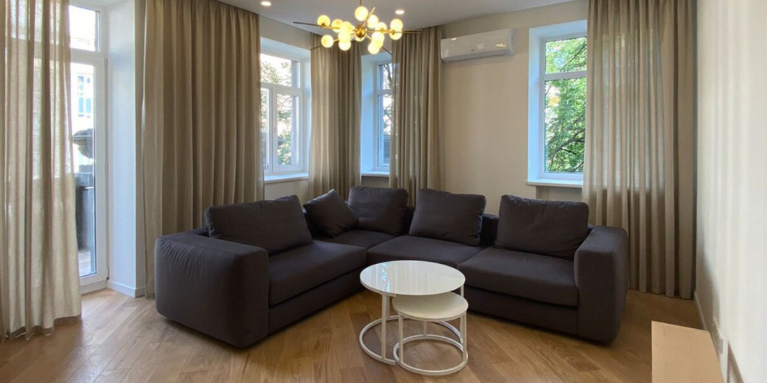 spacious living room with grey sofa