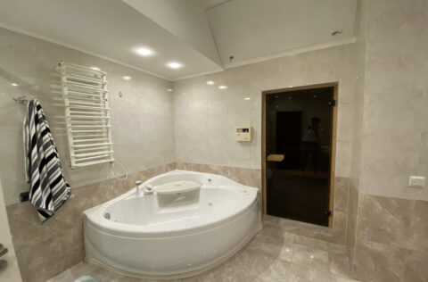 light bathroom with large bathtube