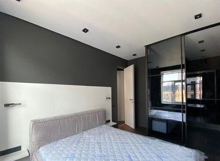 white bedroom and dark wardrobe