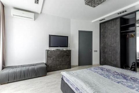 bedroom with tv and aor conditioner