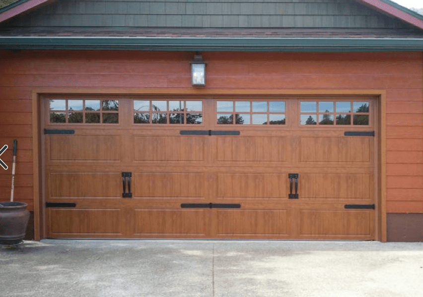 How much does it cost to install  replace a garage door