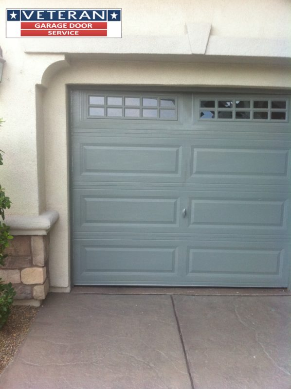 What is the best way to clean the outside of my steel garage door
