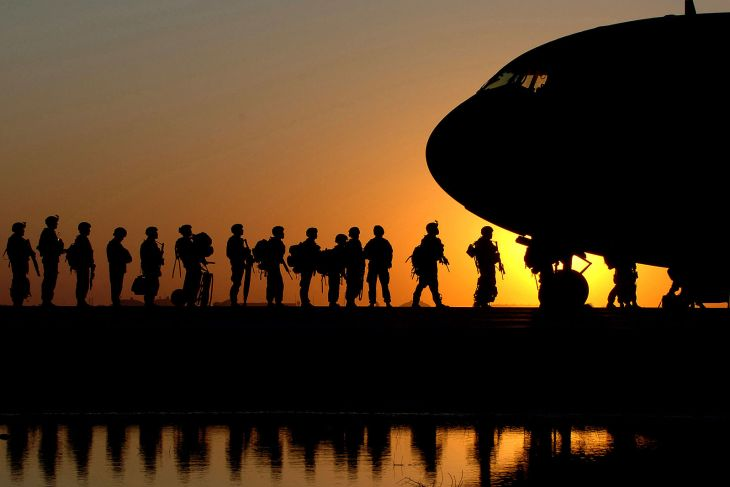 Soldiers wait in line to board an aircraft Nov. 17 at Joint Base Balad, Iraq. (U.S. Air Force photo/Tech. Sgt. Erik Gudmundson)