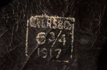 These markings appear to be the maker's mark, the hat's size and the date of manufacture (eBay image).