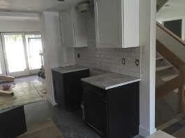 new white cabinets and marble countertops