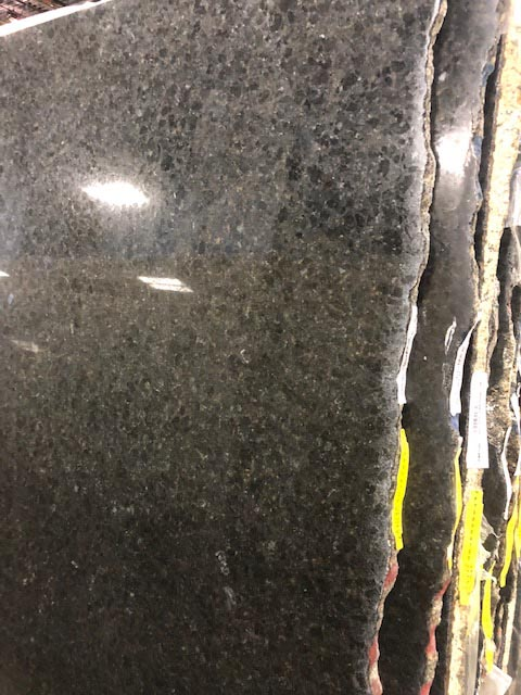 Raw material for a black counter top