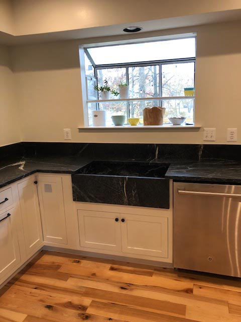 Another kitchen with a black counter top