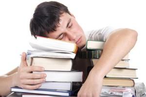 student-sleeping-on-books-300x2001