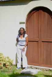 Bayley's Plantation - Vanessa Ferguson Kellman standing in front of the original structure of the slave's chapel