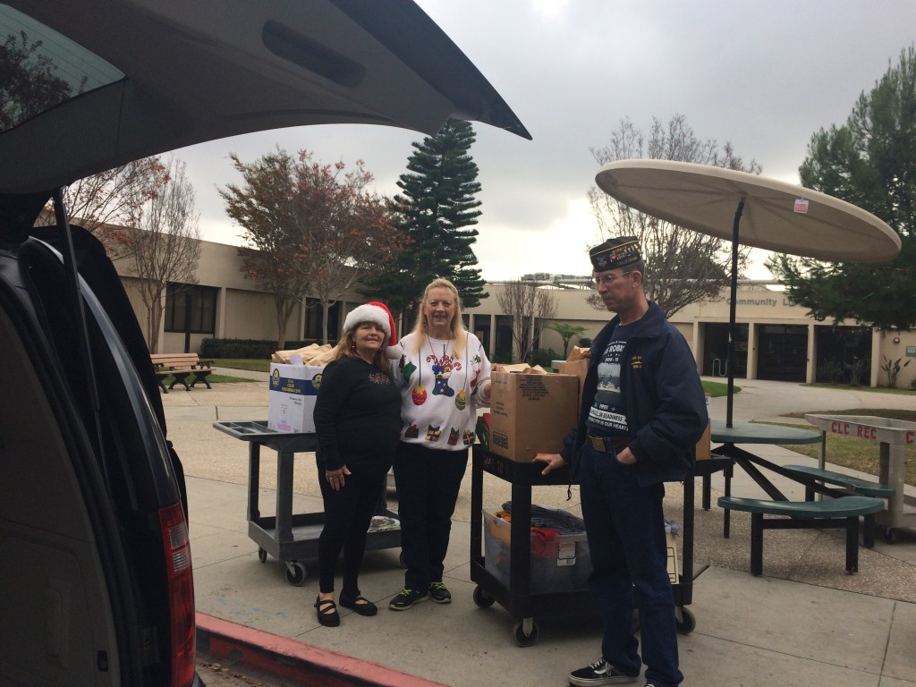 Auxiliary & VFW members unloadng the gift bags to cart