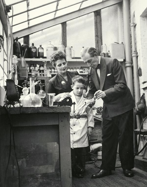 "Richardson with father Cliff in his ""Laboratory"" at home (mum is showing a little interest there, too). The time is 1951."