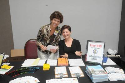 Jody Wade and Teddi Owen are all smiles at the Walk-in Registration table