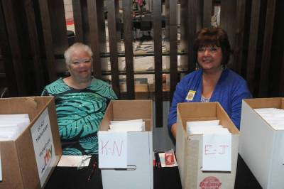 Linda Truman and Ruby Groves are set up for Pre-Registration packet pickup
