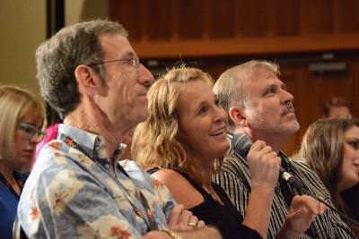 Gary Owen, Lynn Trefzger, and Dan Horn give feedback to Open Mic participants