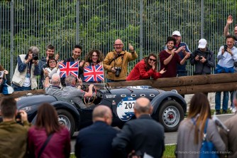 "Steven O'Leary and Robert Eels (UK) on Healey 2400 Silverstone E-Type (1959), wearing Prince Harry and Meghan Markle's masks on the day of the Royal Wedding . Nikon D750, 400 mm (80-400 mm ƒ/4.5-5.6) 1/500"" ƒ/9 ISO 400"