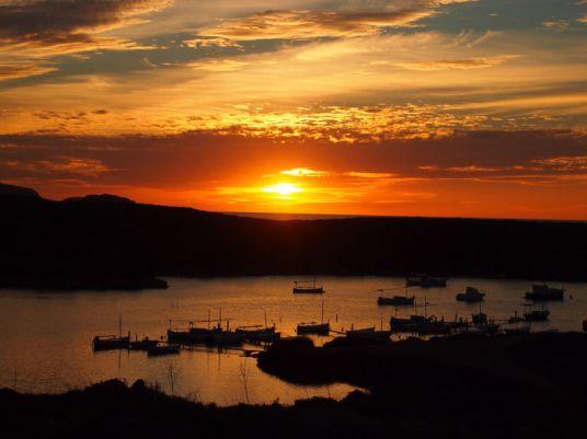 Faro de Cavallería puesta de sol