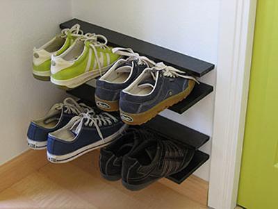 Maneiras de organizar sapatos na entrada de casa