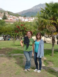My host mom and I with a neighboring pueblo in the background